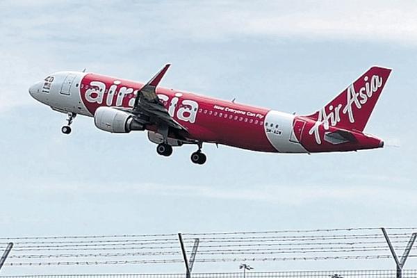 Indonesian divers retrieve 6 more bodies from AirAsia crash