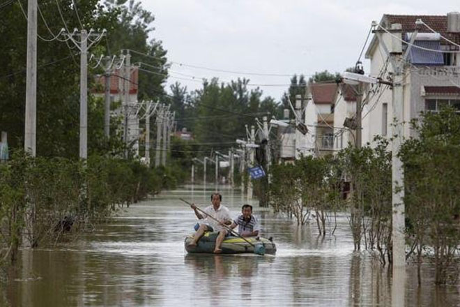 Flooding kills more than 180 people in central and southern China