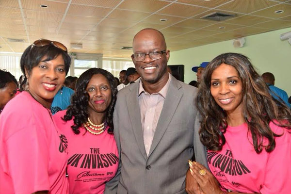Hon. Patrice Nisbett among officials welcoming Nevisians for C-40