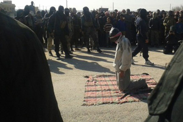 Death and desecration in Syria: Jihadist group 'crucifies' bodies to send message