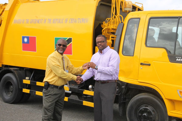 Nevis Health Minister hands over keys for waste disposal truck to Nevis Solid Waste Management Authority