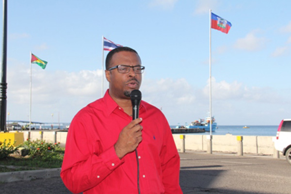 Multiple national flags hoisted on Nevis Waterfront