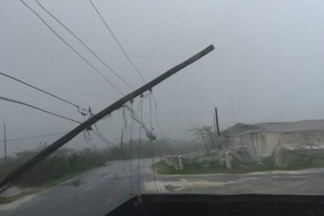 Storm surge forces residents to flee as Matthew pounds Bahamas