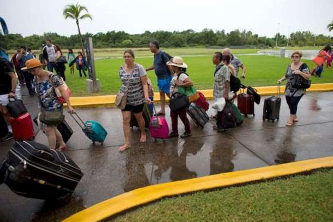 Mega-storm Patricia drenches Mexico as it weakens