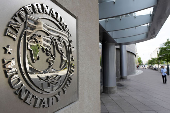 IMF downgrades forecast for world, emerging market economies