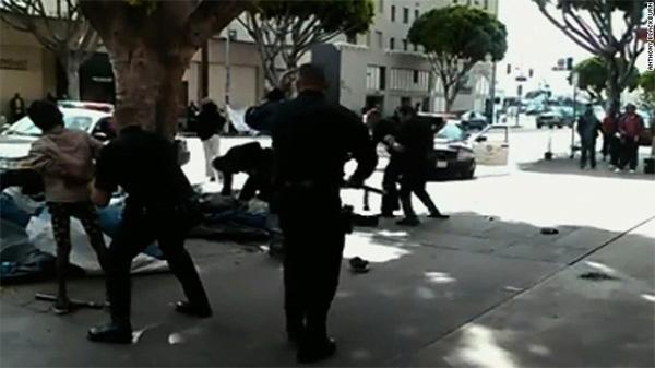 Los Angeles police shoot, kill man on the ground