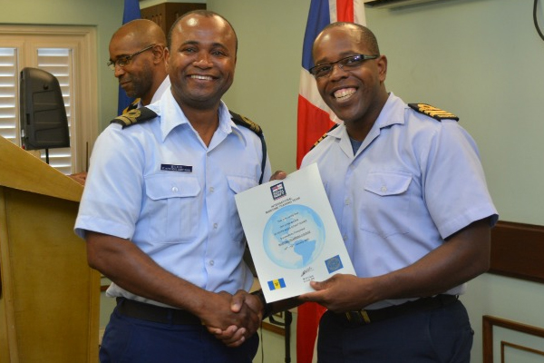 Two local Coast Guard officers complete tactical planning course