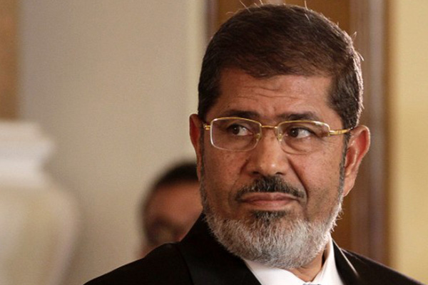 Egypt's Morsy to stand trial on terror charges, state-run media says