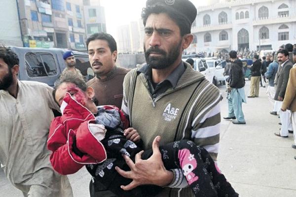 Pakistan massacre survivors vow to defy Taliban