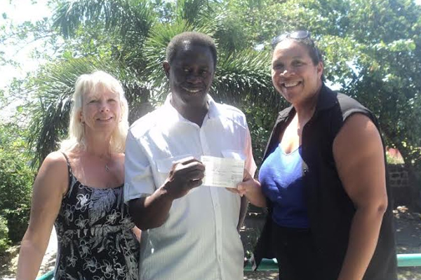 UK based St. Kitts and Nevis Friends Association donates to Pink Lily
