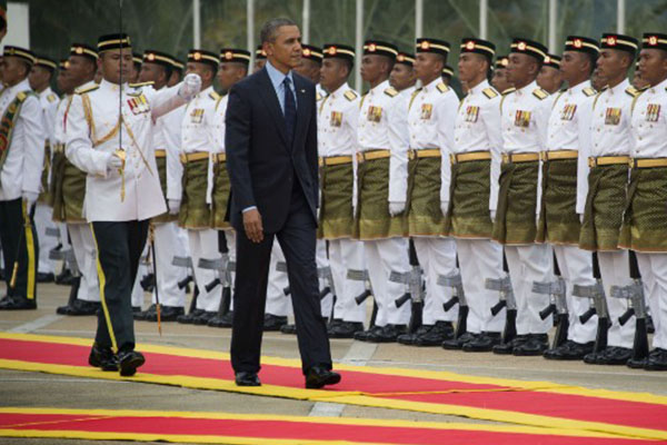 MH370: Obama visits Malaysia as questions loom over missing jetliner