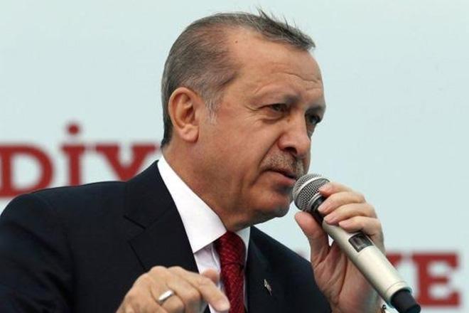 Turkey's Erdogan takes tough EU line after PM quits