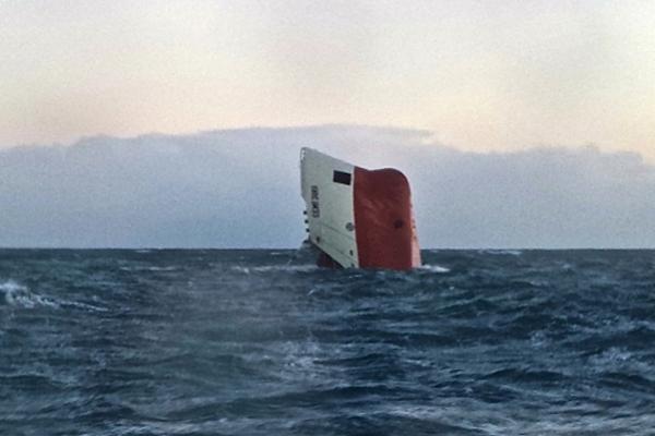 Eight presumed dead after ship sinks off Scottish coast