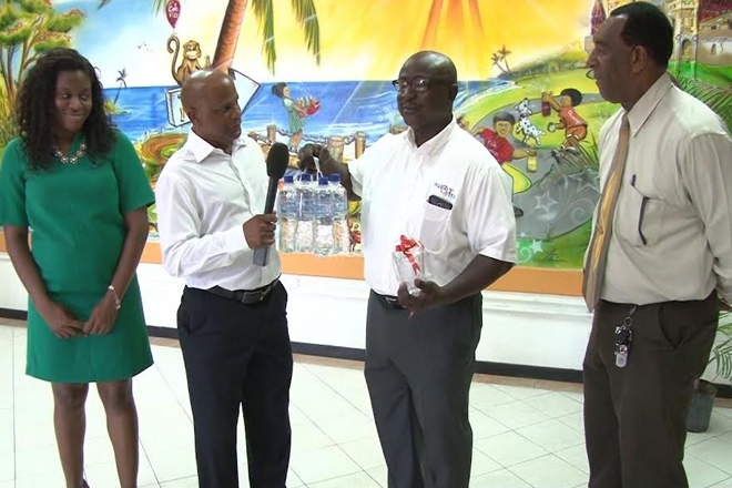 Minister Grant tours Bottling Company