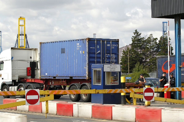 Man found dead, 34 alive in shipping container at UK port