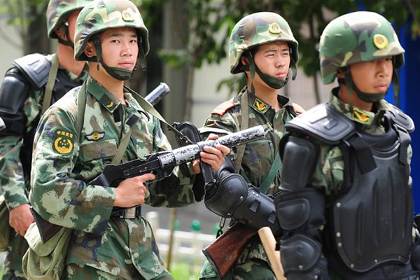 13 attackers die in assault on police station in ethnic Muslim region of China