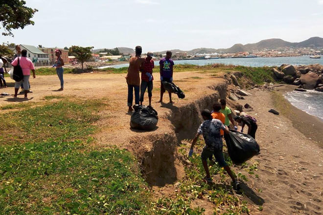 Youth Department staff and volunteers clean up Bay Front