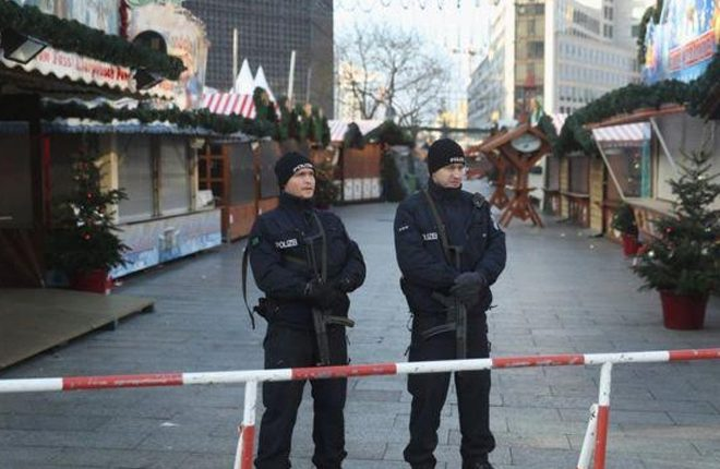 Berlin truck attack: Manhunt across Europe for suspect