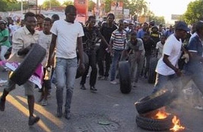 Violent protests follow preliminary election results in Haiti