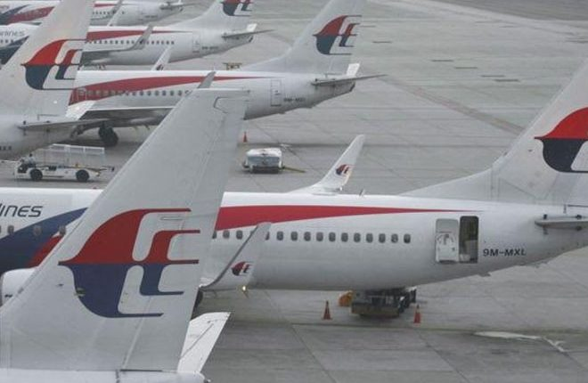 Malaysian Airlines plane turns back after cockpit entry bid