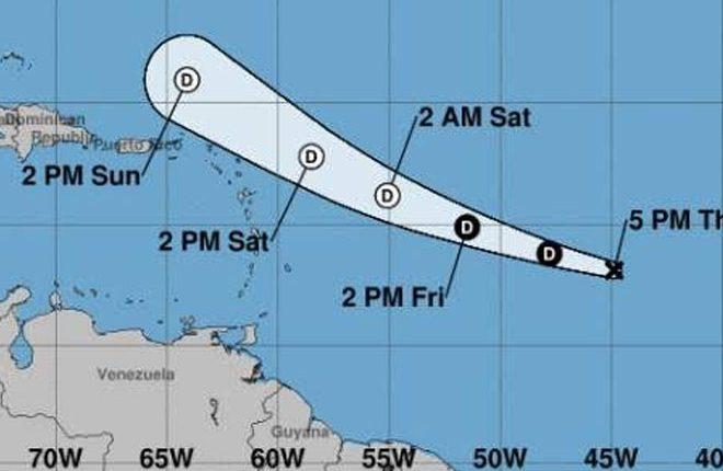 Tropical depression accelerating westward