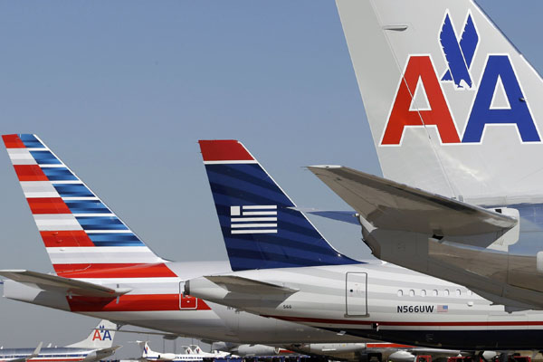 American Airlines, US Airways merging mile programmes in 2015