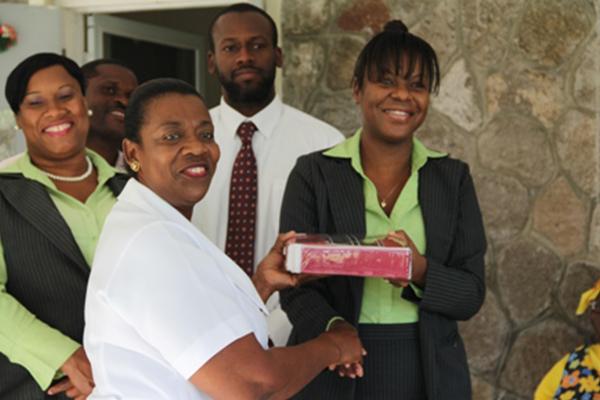 Bank of Nevis Social Club donates to Flamboyant Nursing Home