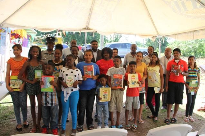 Cane Garden students receive second installment from textbook initiative