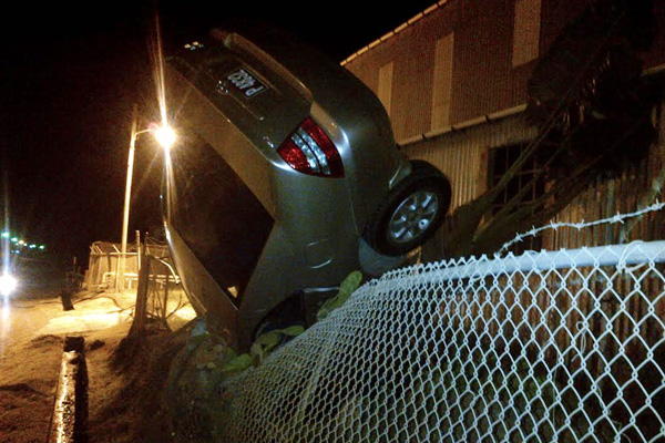 Car overturns on the Power Station's fence
