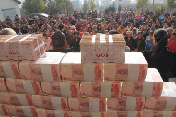 China: Villagers build $2.1M year-end bonus into 'money wall'