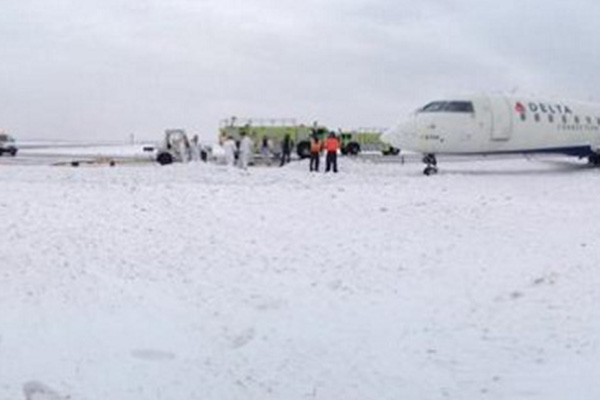 Plane slides off runway at JFK; no injuries