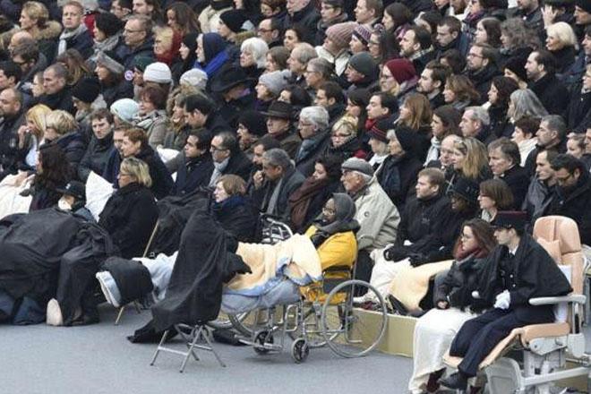 France holds service two weeks after massacre