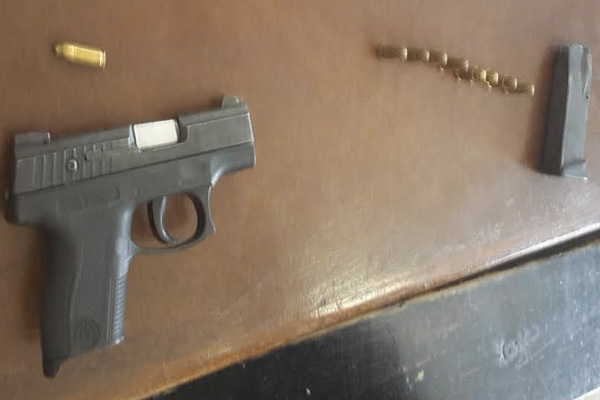 Gun And Ammunition Seized/Police Continue Search