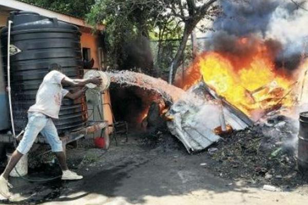 Elderly woman dies in house fire