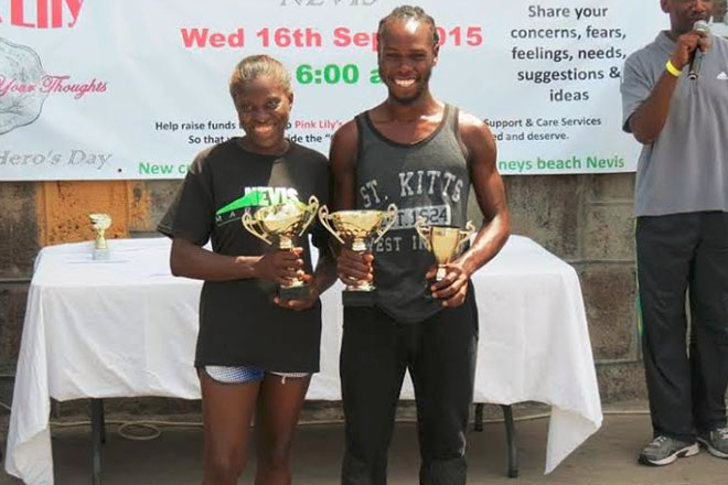 Timoy and repeat Winners in Independence 10k Run