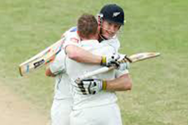 India hangs on for a draw after McCullum triple