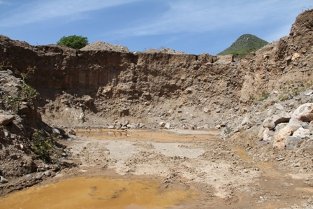 Illegal land mining activities discovered on NIA-owned farm; Nevis Land Minister describes activity as atrocious