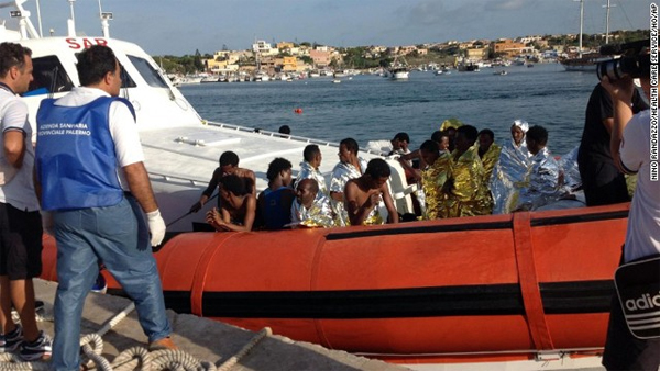 Italian coast guards rescue 700 migrants as EU leaders promise action