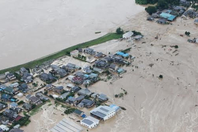 Dozens trapped as floods sweep Japan