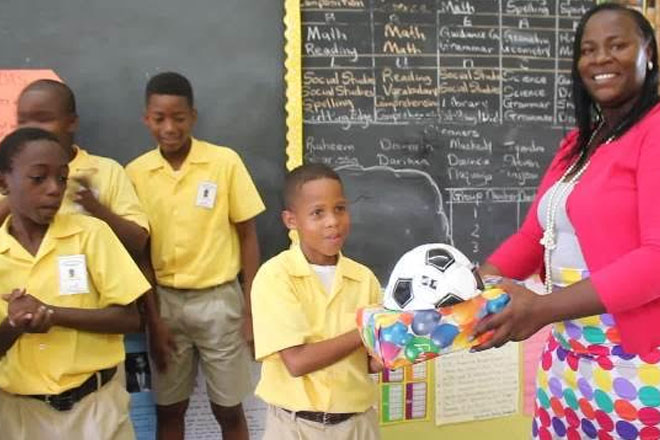 Small Business Owner Donates to Young Footballer