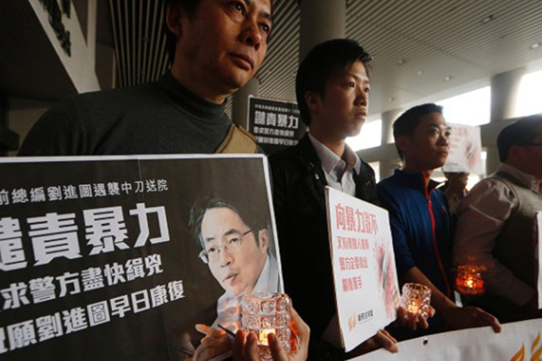 Hong Kong newspaper editor Kevin Lau fights for life after stabbing