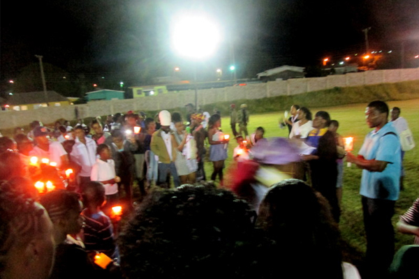 Dr. Terrance Drew coordinates candlelight vigil for St. Peter's teen