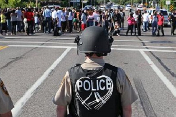 Police tear gas protesters in shooting death of unarmed 18-y-o