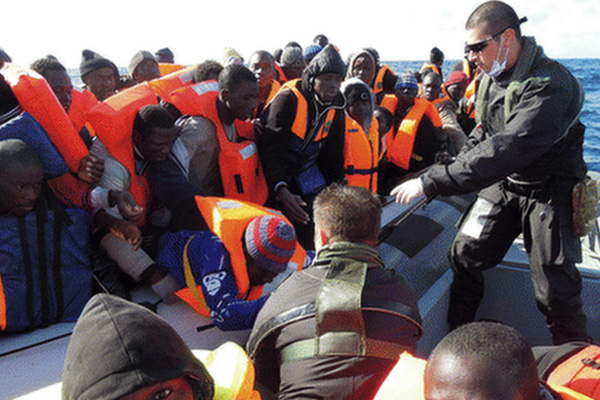 More than 1,100 migrants rescued off Italy in one day
