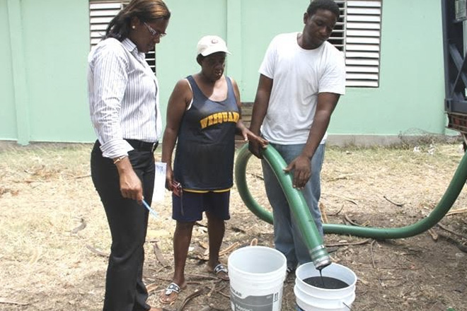Livestock farmer pleased with NIA's assistance with molasses supplement