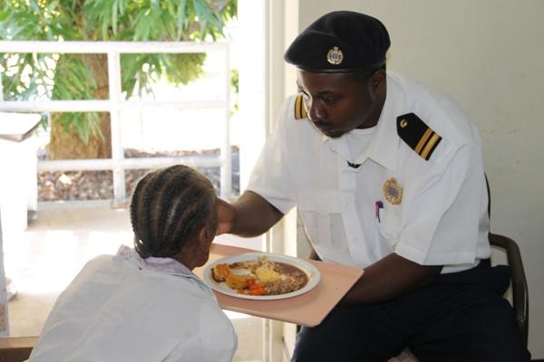 Nevis Custom Officers visit elderly at Flamboyant Nursing Home