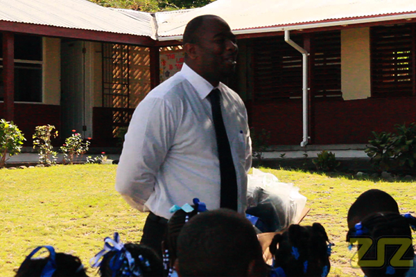 Dr. Wilson Donates to Sandy Point Primary School