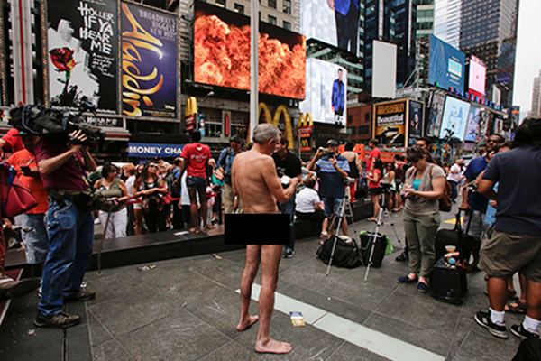 Nude political candidate campaigns in Times Square