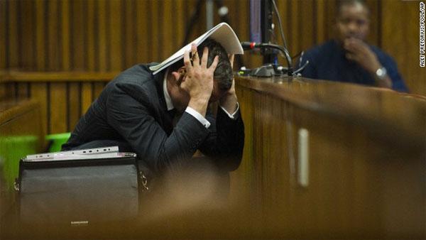 Gruesome shooting scene photos sicken Oscar Pistorius at murder trial