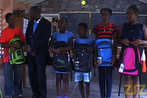 PM Douglas distributes school bags